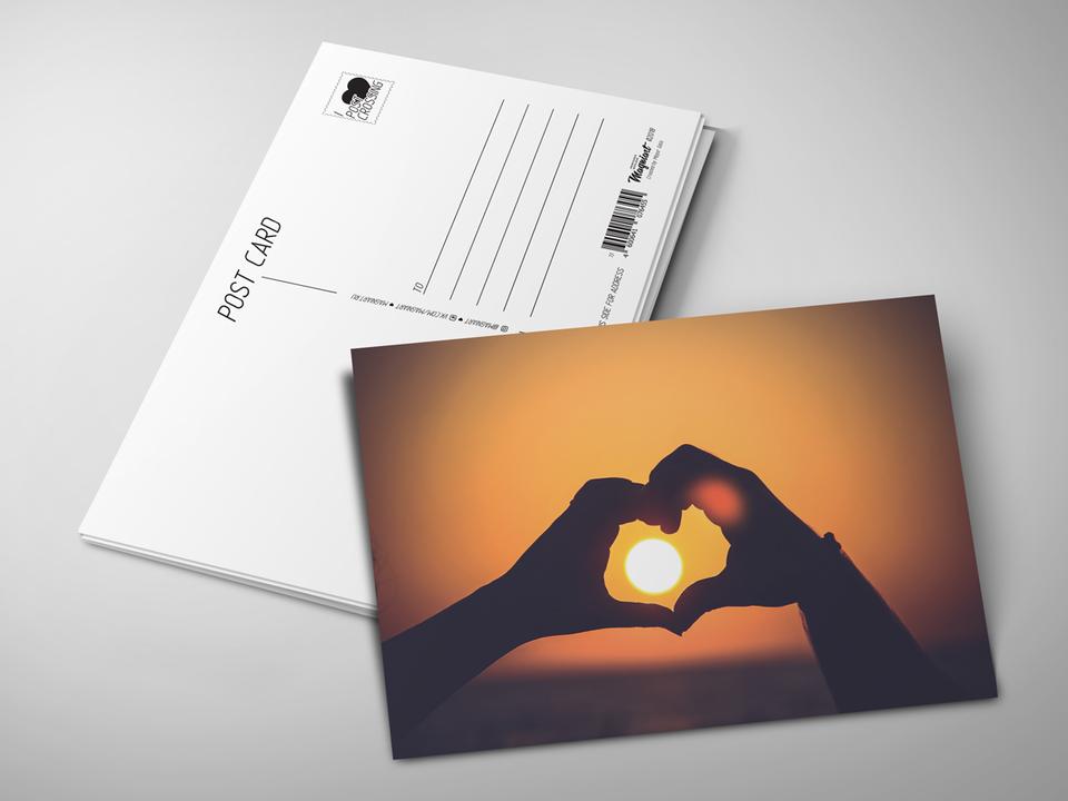 Почтовая открытка из коллекции для посткроссинга «Сердце из рук на закате»